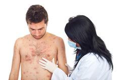 Doctor examine man skin rash - stock photo