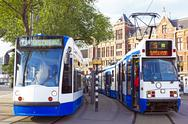 Stock Photo of trams waiting in front of the central station in amsterdam the netherlands