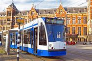 Stock Photo of tram waiting in front of the central station in amsterdam the netherlands