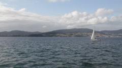 Sailboat crossing Vigo's port Stock Footage