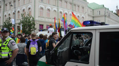Police car with lights protect gay parade participants in street Stock Footage