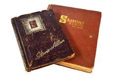Old stamp album book on white - stock photo