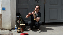 Man play with flute fife pipe in oldtown street event Stock Footage