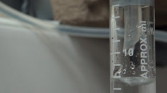 Filling in test tubes Stock Footage
