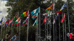 Flags of the world and people walking Stock Footage