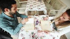 Couple in restaurant reading menus Stock Footage