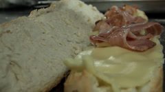 Bakerman making sandwich with cheese and bacon Stock Footage