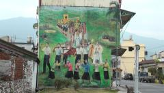 Mural painting on the street with religious procession scene in Wanchin Stock Footage