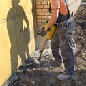 Stock Photo of construction site, worker and jackhammer tool