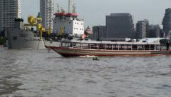 Passenger boats in Chao Phraya river, Bangkok, Thailand. Stock Footage