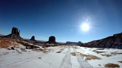 POV driving road Monument Valley winter landscape snow climate Arizona USA Stock Footage
