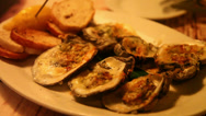 Stock Video Footage of Grilled oyster, with someone eating it
