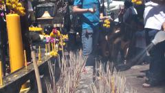 People offering incense and flowers to Phra Phrom. Thailand Stock Footage