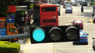 Stock Video Footage of T/L Asia Singapore downtown traffic commuters bus stop traffic light