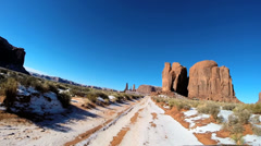 Stock Video Footage of POV Monument Valley driving winter snow extreme terrain Buttes Utah USA
