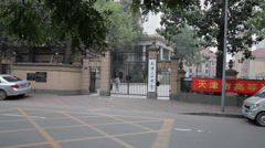 Students prepare for exams outside the school gate,China Stock Footage