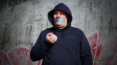 Demonstrator with a tape on a mouth episode 5 - stock footage