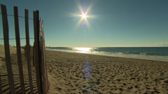 brilliant sun at an autumn beach - stock footage