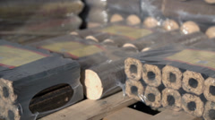 Lumps of packed wooden briquettes Stock Footage