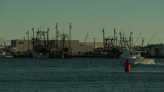 Fishing boat motoring through the harbor Stock Footage
