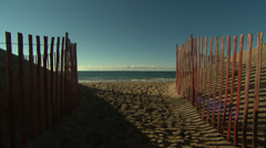 Beach with snow fence in fall Stock Footage