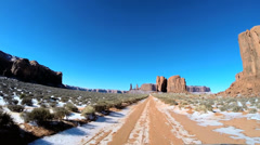 POV vehicle winter snow driving Tribal Indian Park Monument Valley sun flare - stock footage