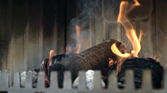 Briquette surrenders to the fire - stock footage