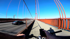 POV Bicycle riding Smart phone Wifi Golden Gate Bridge, San Francisco, Californi Stock Footage