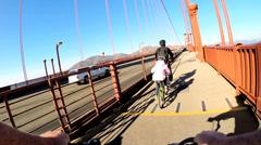 POV Bicycle riding pedal power  traffic Golden Gate Bridge San Francisco USA - stock footage