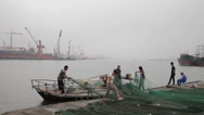 Stock Video Footage of Fishermen arranging nets in tianjin harbor,Tianjin, china.