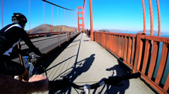 POV Bicycle rider San Francisco Bay Golden Gate Bridge people USA Stock Footage