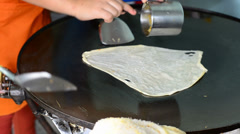 Frying Roti , traditional indian food made of flour Stock Footage