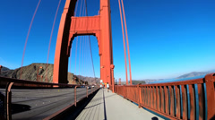 Stock Video Footage of POV Cycle rider Golden Gate Bridge traffic San Francisco USA
