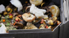 Tight shot of compost bin - stock footage