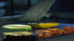 Cooking vegetables on the grill - stock footage