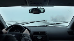Driving in the snow in slow motion Stock Footage