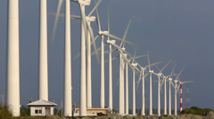 Turbines turning on wind farm Stock Footage