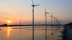 Sunset view of salt pons and turbines on wind farm Stock Footage