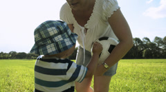 Mother lifting up baby boy Stock Footage