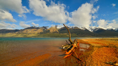 Moving Cloud Over Lake And Mountain - stock footage