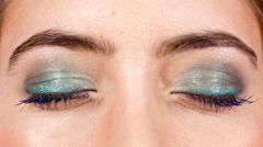 Makeup cosmetics close-up beautiful woman Stock Footage