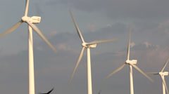 Rotating turbine blades on wind farm Stock Footage