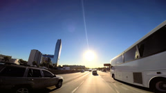 POV city suburbs Highway driving built structure sun flare Los Angeles USA - stock footage
