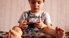 Portrait of a child playing with a smartphone Stock Footage