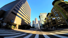 POV drive wide angle downtown city skyscrapers vehicle traffic Los Angeles USA - stock footage