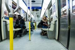 people texting inside the montreal metro - stock photo