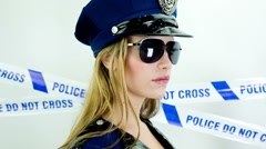 Sexy police female dancer Stock Footage