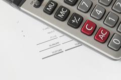 calculator on finance statement - stock photo