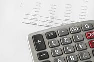 Stock Photo of calculator on finance statement
