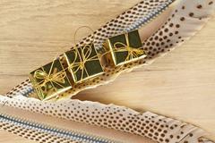 triple golden box on feather - stock photo
